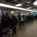 People queing at currency exchange offices as swiss franc gains value