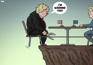 Brexit cartoon Boris Johnson sitting on edge of a cliff with scissors about to cut himself loose saying i'm warning you to european union