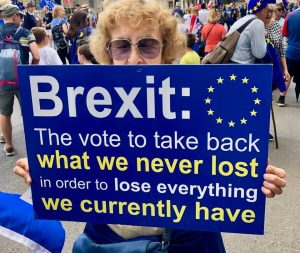 Brexit joke protest A woman holding a sign saying the vote to take back what we never lost