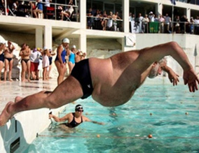 fat man jumps in a swimming pool