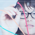 Girl drawing on a transparent board forex charts