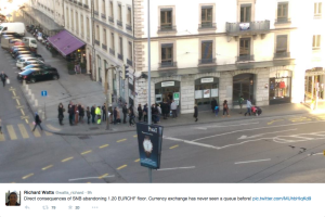 swiss people queing at the currency exchange as swiss franc gains value against euro