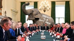 Brexit meme elephant in the room with a sign that brexit is a shit idea in front of politicians
